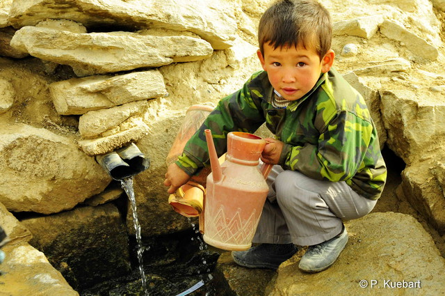 Boy getting water, Lal